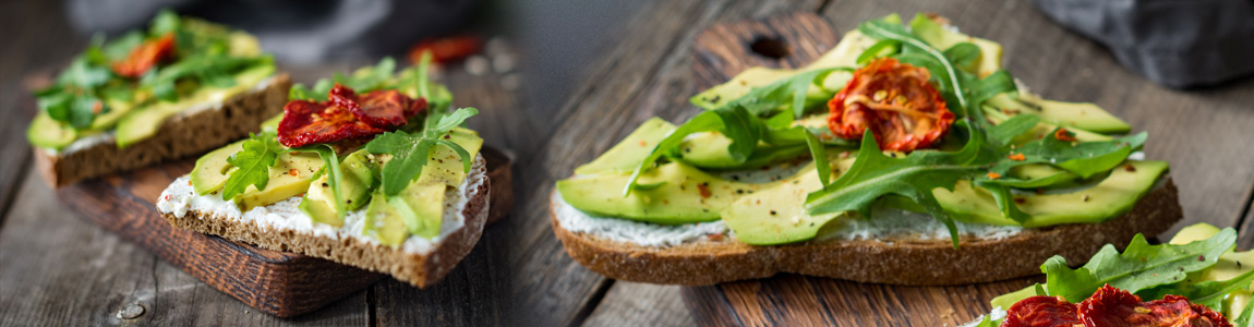 Healthy toast with avocado, white cheese and arugula